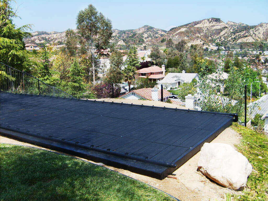 Enersol Solar Pool Heaters installed on a custom made rack in the mountains of California