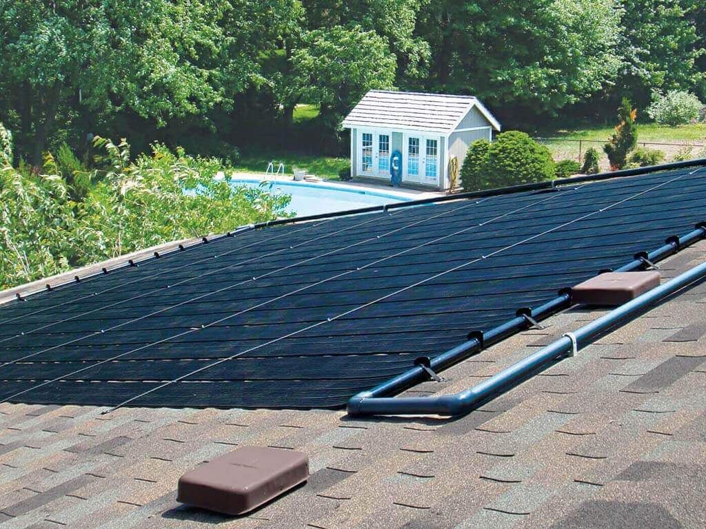 Enersol Solar Pool Heater Residential Roof Installation for an in-ground pool and the pool house