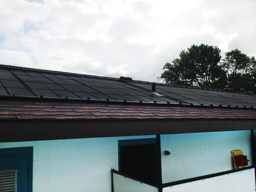 closeup of the Enersol Solar Pool Heaters installed around roof vents at the Kirkton-Wodham Community Centre